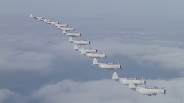 ms aerial ts shot of bomber airplanes flying in formation over ocean - formationsfliegen stock-videos und b-roll-filmmaterial