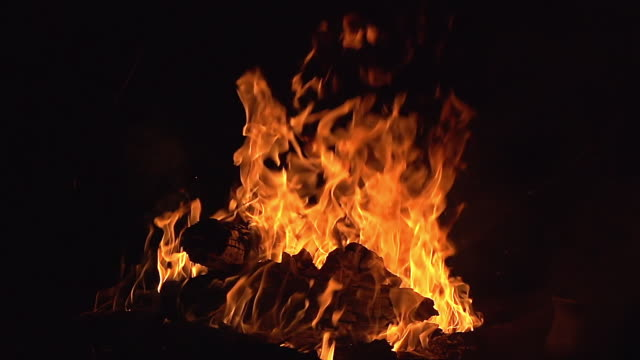 CU SLO MO Shot of Bonefire, Fire flames in campfire / Moremi Reserve, Botswana, South Africa