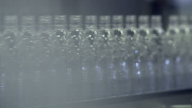 ms shot of bottling plant at beverage industry / gerolstein, rhineland palatinate, germany  - abundance stock videos & royalty-free footage