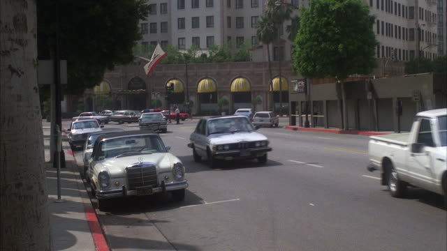 ms td pan shot of boulevard traffic by left to right - beverly hills california stock videos & royalty-free footage