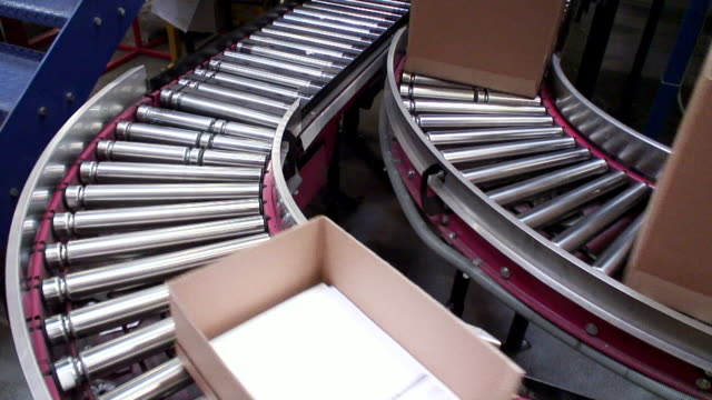 ms shot of box moving onconveyer belts in warehouse / hamburg, germany - conveyor belt stock videos and b-roll footage