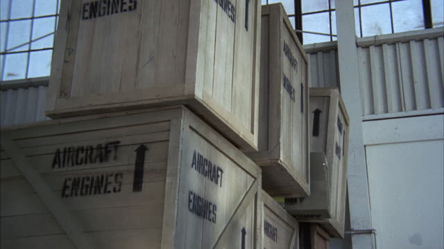 MS TS Shot of Boxes falling at warehouse / Los Angeles, California, United States