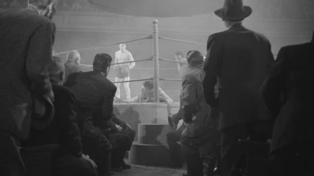 MS Shot of boxing match with audience sitting several rows