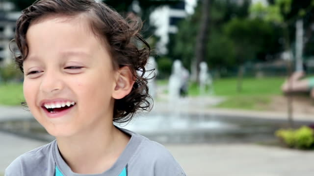 CU SLO MO Shot of boy smiling / Quito, Ecuador