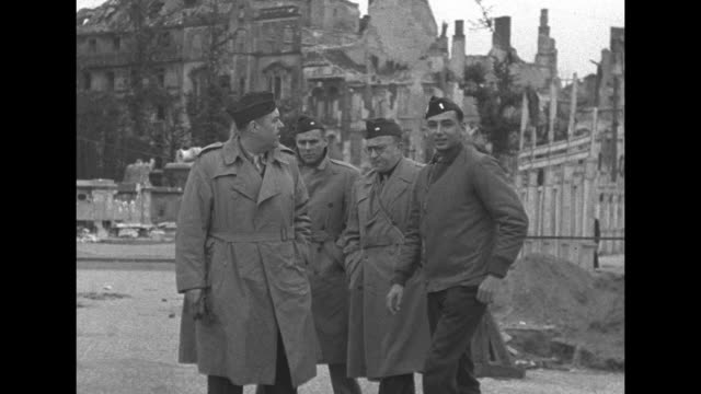 Shot of Brandenburg Gate / Ernest Harmon and other US officers getting out of car in front of Gate / Harmon on left and other officers walking along...