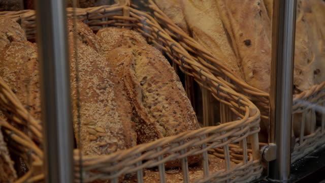 vídeos y material grabado en eventos de stock de cu pan shot of bread is put on display / copenhagen, seeland, denmark    - oresund escandinavia