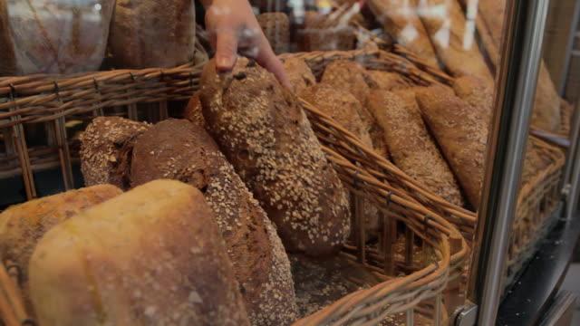 vídeos y material grabado en eventos de stock de cu shot of bread is put on display / copenhagen, seeland, denmark    - oresund escandinavia