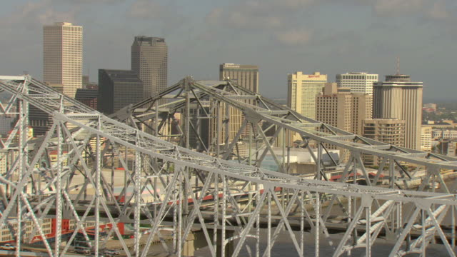 ms aerial shot of bridge and downtown / new orleans, louisiana, united states - new orleans stock videos and b-roll footage