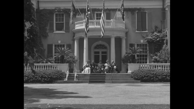 Shot of British and American flags projecting from balcony at Franklin Roosevelt's Springwood mansion in Hyde Park / WV porch beneath balcony / WV...