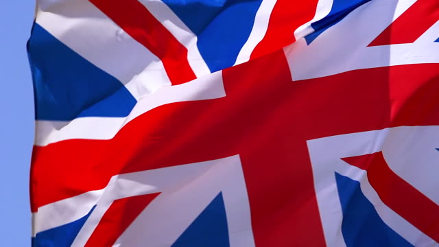 cu slo mo shot of british flag waving in wind / caen, normandy, france - bandiera del regno unito video stock e b–roll