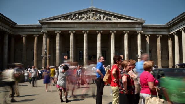 ms t/l shot of british museum london sunny summer's day blurred visitors arriving from main gate on great russell street towards main entrance / london, greater london, united kingdom - greater london stock videos and b-roll footage
