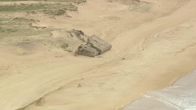 vidéos et rushes de ws aerial shot of broken objects near coast / aquitaine, france - aquitaine