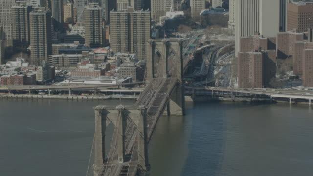 """WS PAN ZI ZO AERIAL Shot of Brooklyn Bridge with USA Flag / New York City, United States"""