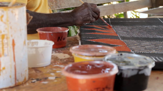 cu shot of brush as man painting tiwi art / northern territory, australia - tiwi people stock videos & royalty-free footage
