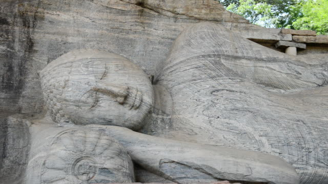 cu shot of buddas statue in polonnaruwa temple / polonnaruwa, north central province, sri lanka  - sri lankan culture stock videos & royalty-free footage