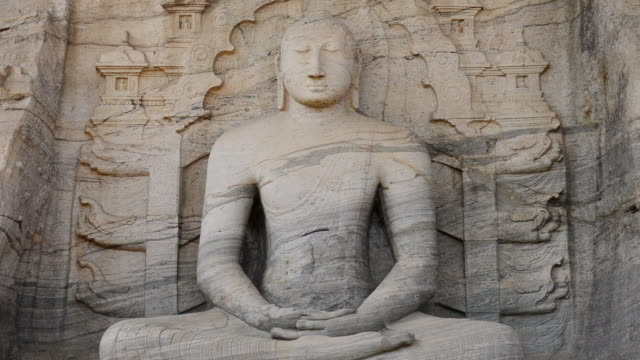 ms shot of buddas statue in polonnaruwa temple / polonnaruwa, north central province, sri lanka  - sri lankan culture stock videos & royalty-free footage