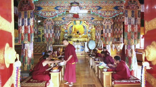 MS Shot of Buddhist monks dinning in temple Matho Monastery / Ladakh, India