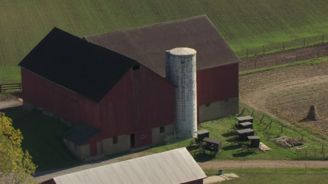MS DS AERIAL Shot of buggies parked outside barn at Amish farm in Richland County / Ohio, United States