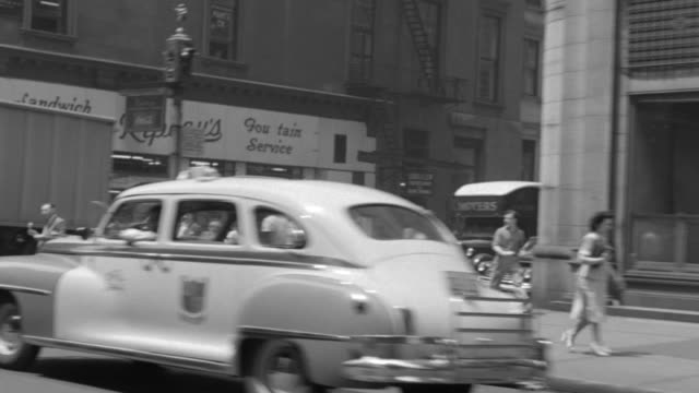 ms pov shot of building aparment, vehicle moving on street with people walking on sidewalk - butiksskylt bildbanksvideor och videomaterial från bakom kulisserna