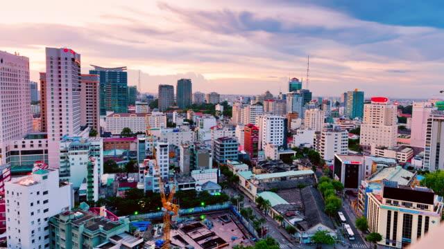 ws t/l pan shot of building in city / ho chi minh city, vietnam - vietnam meridionale video stock e b–roll