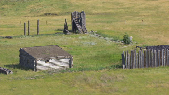 ms aerial ts shot of building remains and fence at fort manuel / kenel, south dakota, united states - grass family stock videos & royalty-free footage