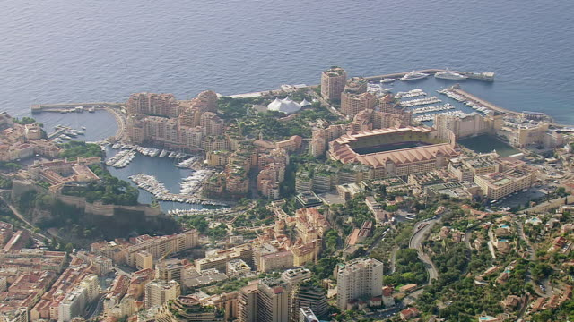 ws aerial shot of buildings and boats on harbor along coast / monaco, france - monaco stock videos and b-roll footage