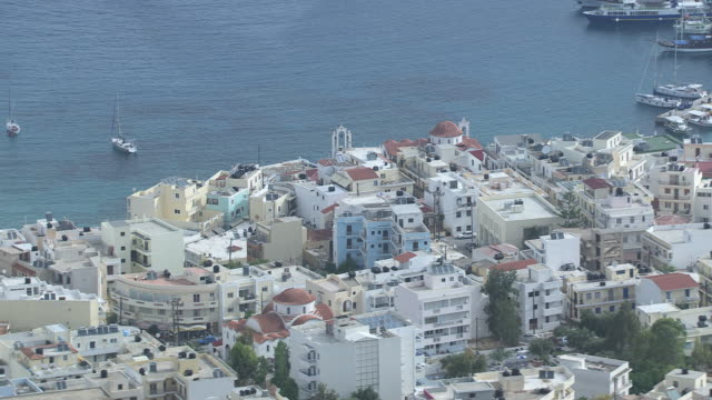 MS AERIAL Shot of buildings at bay / Karpathos, Dodecanese, Greece