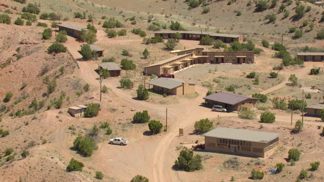 MS AERIAL Shot of buildings at Ghost Ranch retreat and education center / Abiquiu, New Mexico, United States