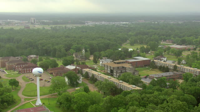 ms aerial tu shot of buildings at tougaloo college with tall water tower / jackson, mississippi, united states - jackson stock videos & royalty-free footage