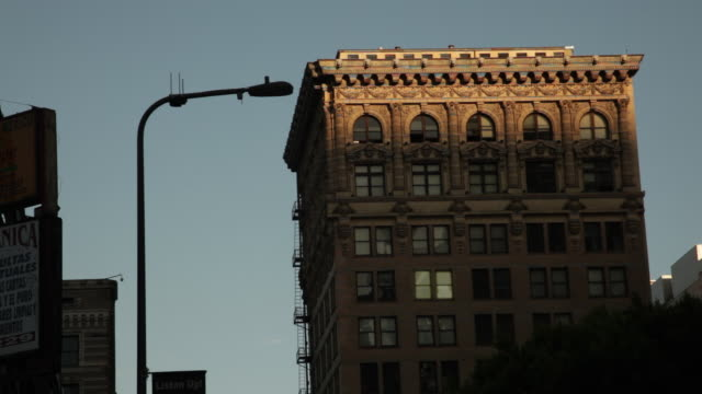 MS T/L Shot of Buildings during sunrise / Los Angeles, California, United States
