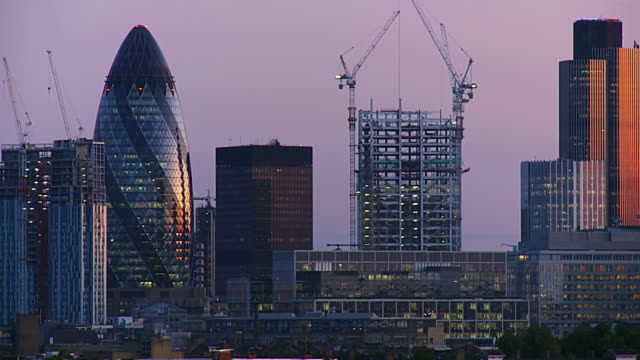 ms t/l shot of buildings of city of london from dusk to night / london, united kingdom  - tower stock videos & royalty-free footage