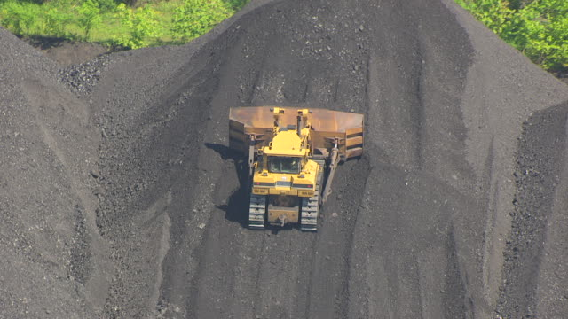 ms aerial zo shot of bulldozer moving coal pile in east kentucky / kentucky, united states - coal mine stock videos & royalty-free footage