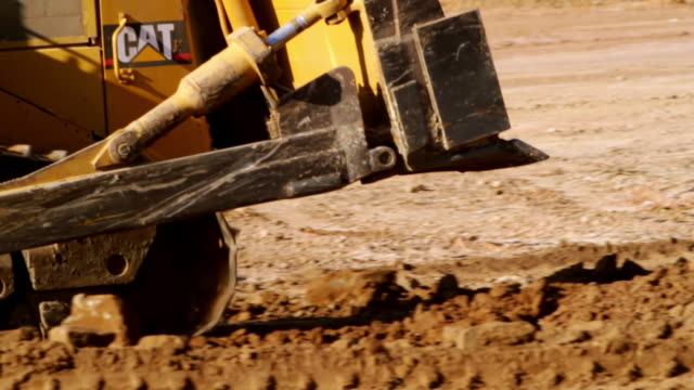 cu pan shot of bulldozer working on site / oran park, new south wales, australia - bulldozer stock videos and b-roll footage