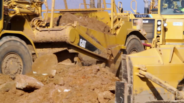 ms shot of bulldozer working on site / oran park, new south wales, australia - bulldozer stock videos and b-roll footage