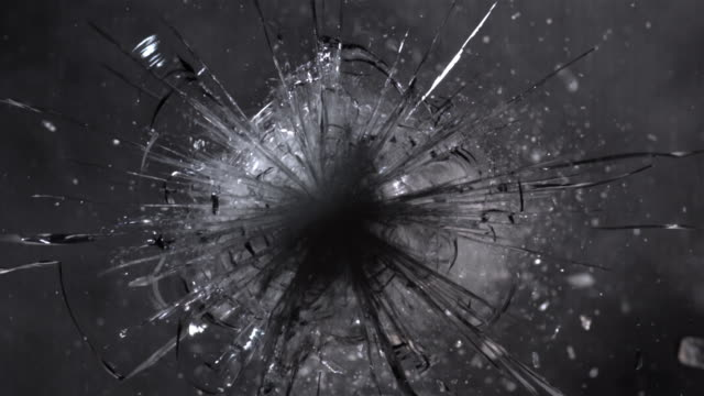 cu slo mo shot of bullet hitting armored windscreen - 破壊点の映像素材/bロール