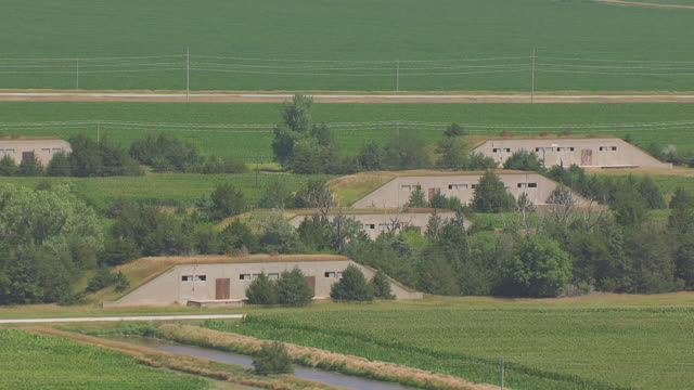 ms aerial shot of bunkers at naval ammunition depot / hastings, nebraska, united states - 防空壕点の映像素材/bロール