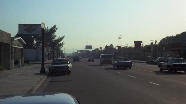 ms shot of burbank street (magnolia boulevard) with general traffic - burbank stock-videos und b-roll-filmmaterial