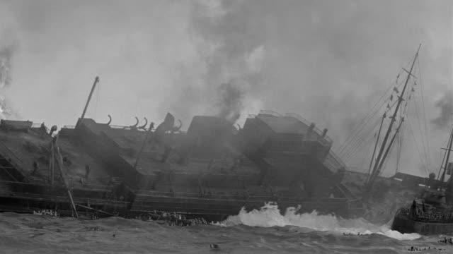 MS Shot of burning battle ship in ocean (miniature)