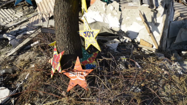 shot of burnt tree with hope signs that the community hung - emergencies and disasters stock videos & royalty-free footage