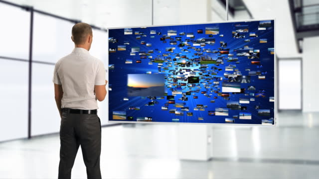 MS Shot of Business man using big media screen / Bergen, Hordaland, Norway
