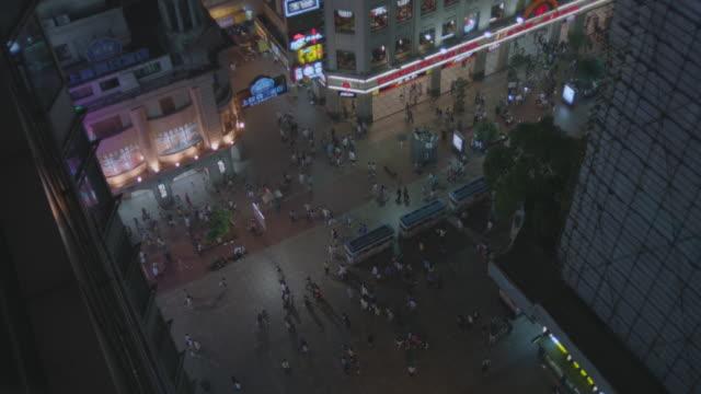 MS HA SLO MO Shot of busy main street in city at night / Shanghai, China