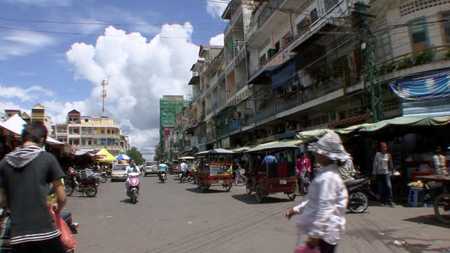 ms shot of busy street at market in phnom penh city / phnom penh, cambodia - phnom penh stock videos and b-roll footage