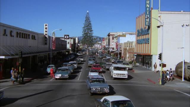 ms shot of busy street at small town - insegna di negozio video stock e b–roll