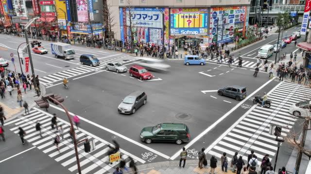 WS T/L HA Shot of busy street crossing in Akihabara in morning / Tokyo, Japan
