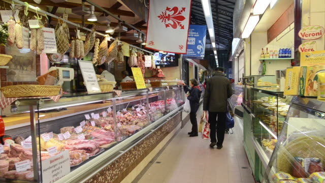 MS Shot of Butcher shop and customers in Ambrogio market / Florence, Tuscany, Italy