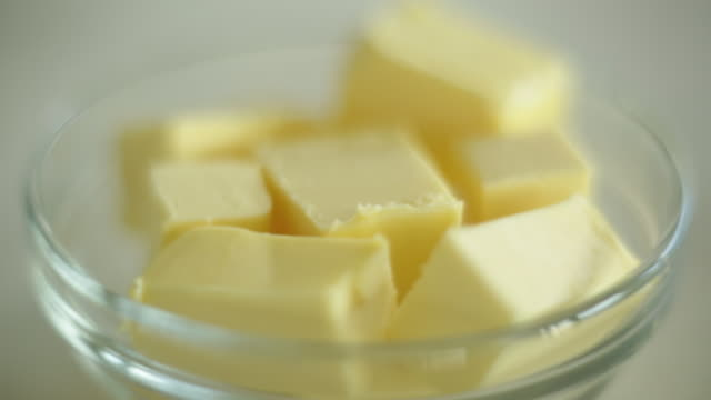 cu pan shot of butter cubes in glass bowl / auckland, new zealand - butter stock videos & royalty-free footage