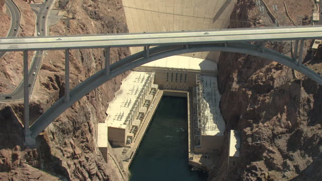ms aerial shot of bypass roadway connecting two rocky mountains at hoover dam / nevada, united states - hoover dam stock videos and b-roll footage