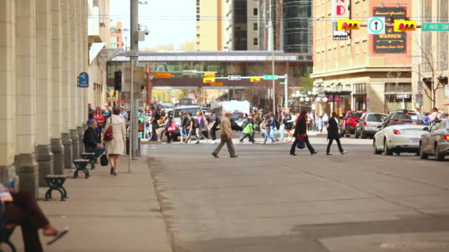 vídeos de stock, filmes e b-roll de ms shot of c train traffic and people in downtown / calgary, alberta, canada - calgary