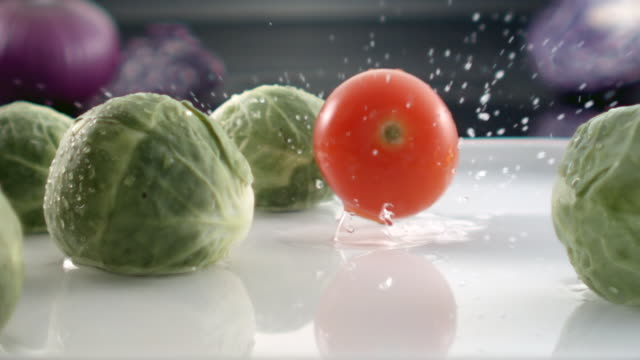 ECU SLO MO Shot of Cabbage falling on plate filled with water and cabbages/ Seoul, South Korea