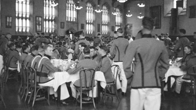 MS Shot of cadets eating in west point dining room
